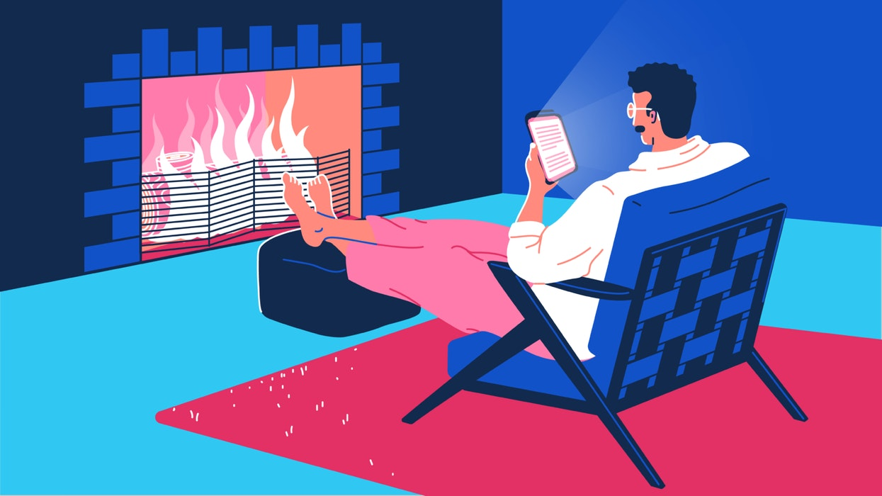 mixkit-man-sitting-in-front-of-a-fire-reading-from-a-66-original-large.jpg